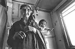 Grandmother with child in train wagon